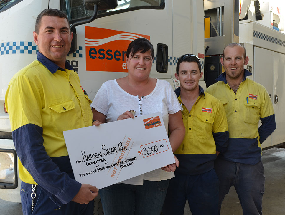 Kai Steele with members of the team at Essential Energy, Jamie Cantrill and Allan Byrne, presenting Michelle Irving with a cheque for $3,500 towards the construction of the Harden Skate Park.